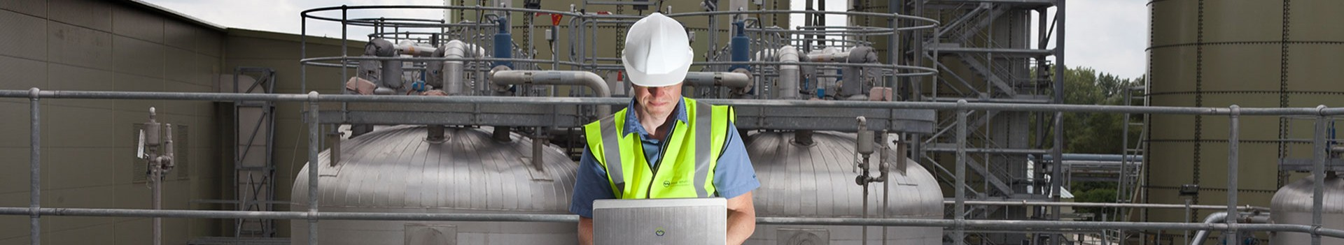Man in work clothes on laptop